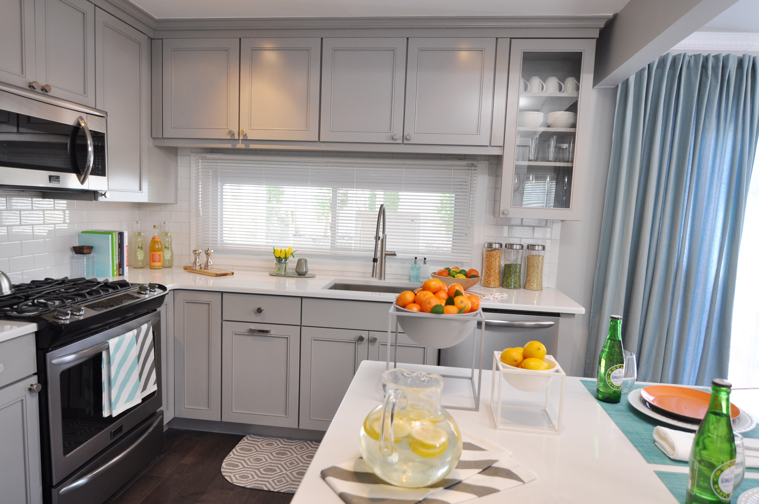 Kim Mitchell_Production Designer_HGTV_Buying and Selling with The Property Brothers_Season 3_Episode 316_Kitchen Remodel_Grey Kitchen Cabinets_Kitchen Staging.jpg