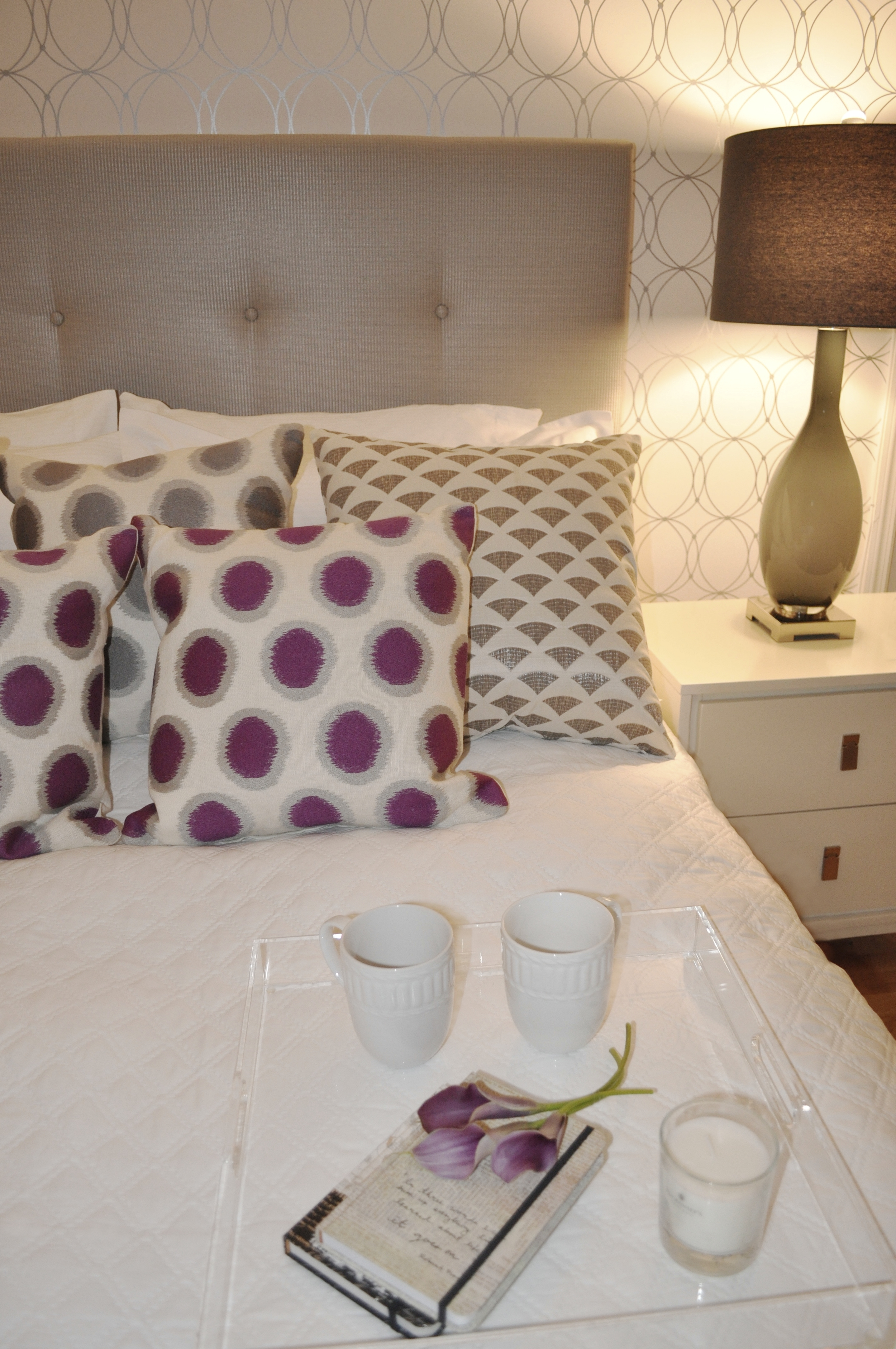 Kim Mitchell Production Designer_HGTV_Buying and Selling with The Property Brotehrs_Season 3_Episode 315_Master Bedroom Design_Headboard_Grey and Purple Pillows_Silver Wallpaper.jpg