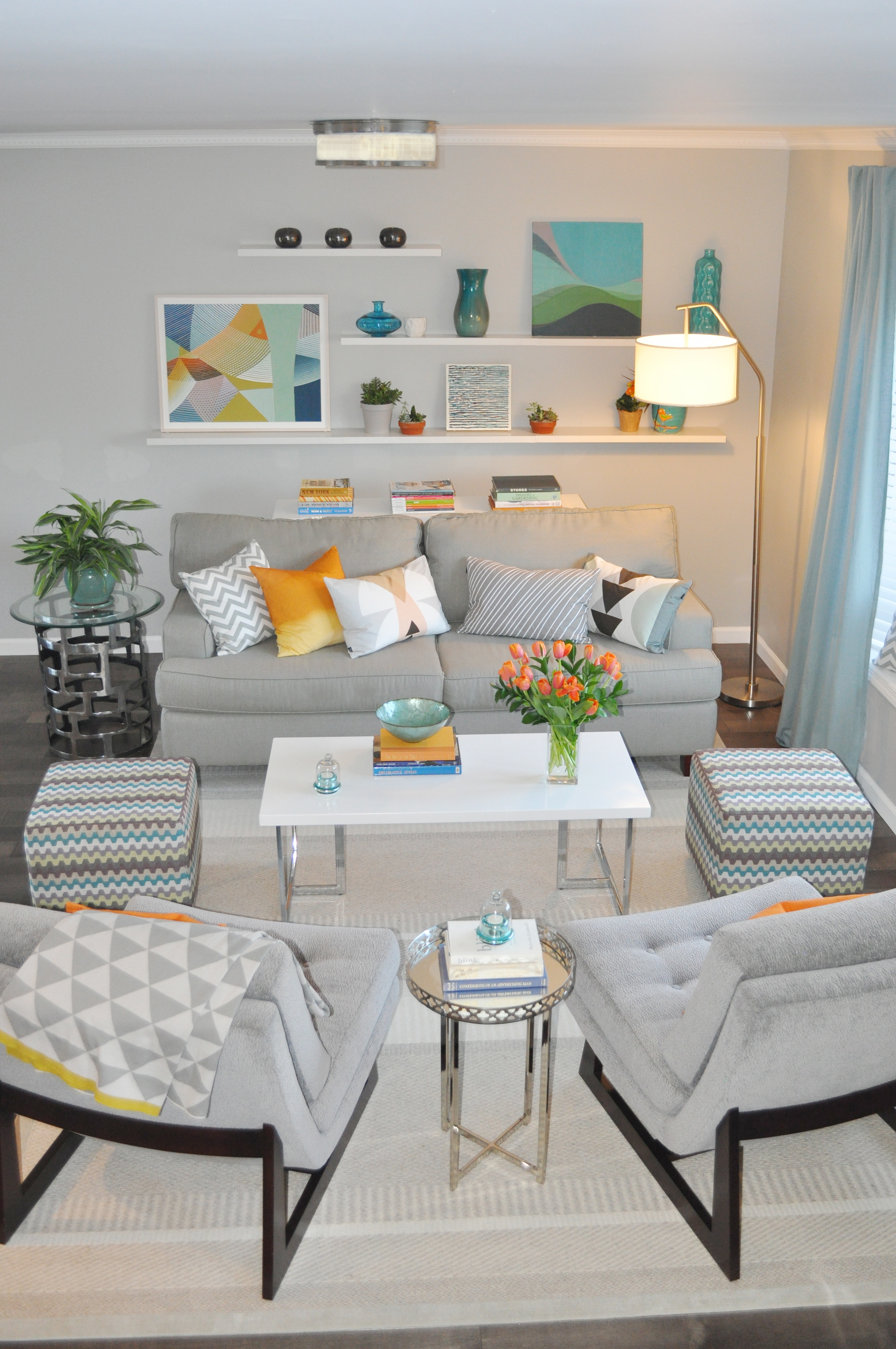 Kim Mitchell Production Designer_HGTV_Buying and Selling with The Property Brothers_Season 3 _Episode 316_Living Room Design_Pop of Color with Gray_Art by Kenise Barnes Gallery_Kontrast_Evas Decorating Chairs_Scandecor Rug_Churchill__Hudson Valley.jpg