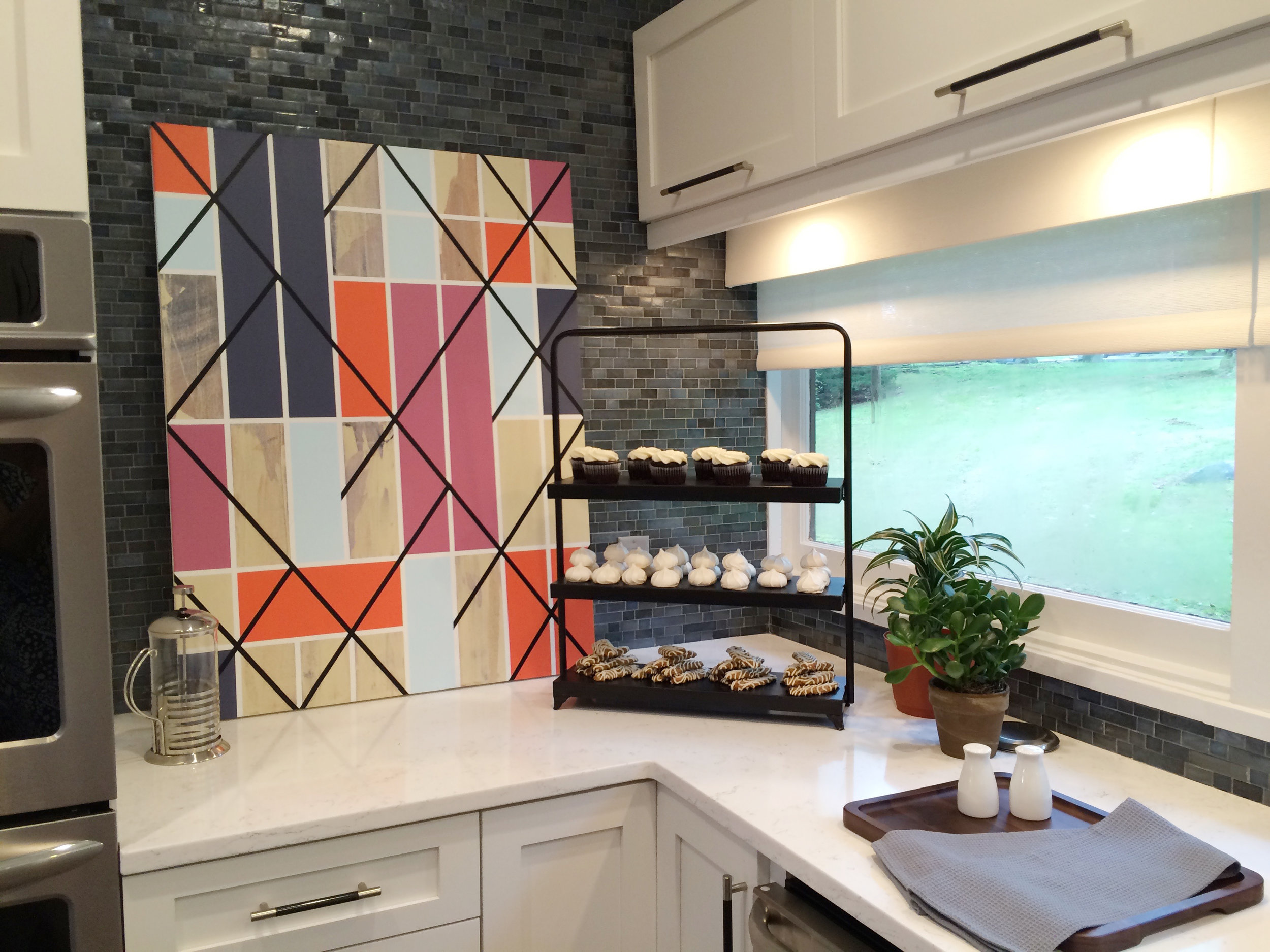 Kim A Mitchell_Design Lead_HGTV_The Property Brothers_Season 6_Episode 9_Kitchen_Blue Glass Tile Backsplash_Kenise Barnes Fine Art_Emtek Hardware_Modern Kitchen_2017.jpg