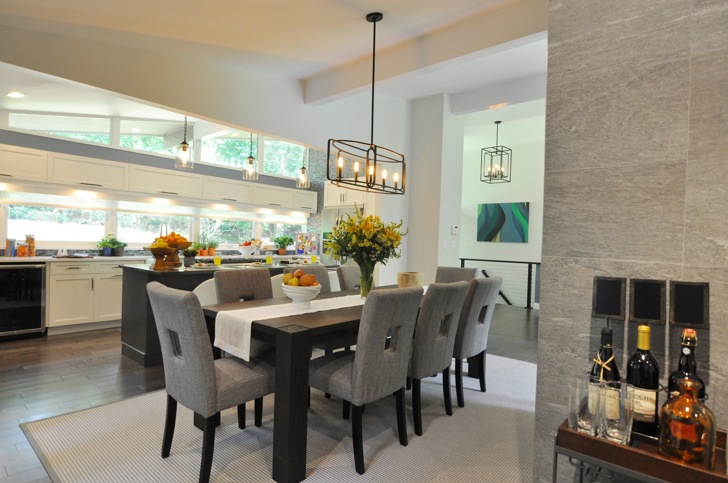 Kim A Mitchell_Design Lead_The Property Brothers_Season 6_Episode 9_Modern Dining Room_Crate and Barrel Dining Table_Open to White Kitchen_Scandecor Rug_Blue Gray Dining Room_2017.jpg