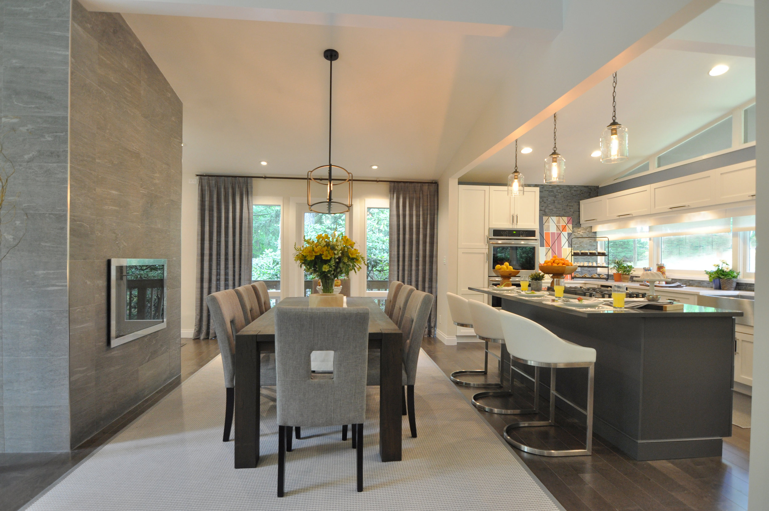 Kim A Mitchell_Design Lead_The Property Brothers_Season 6_Episode 9_Modern Dining Room_Tile Fireplace Wall_Gas Fireplace_Open to Kitchen_Scandecor Rug_Blue Gray Dining Room_2017.jpg