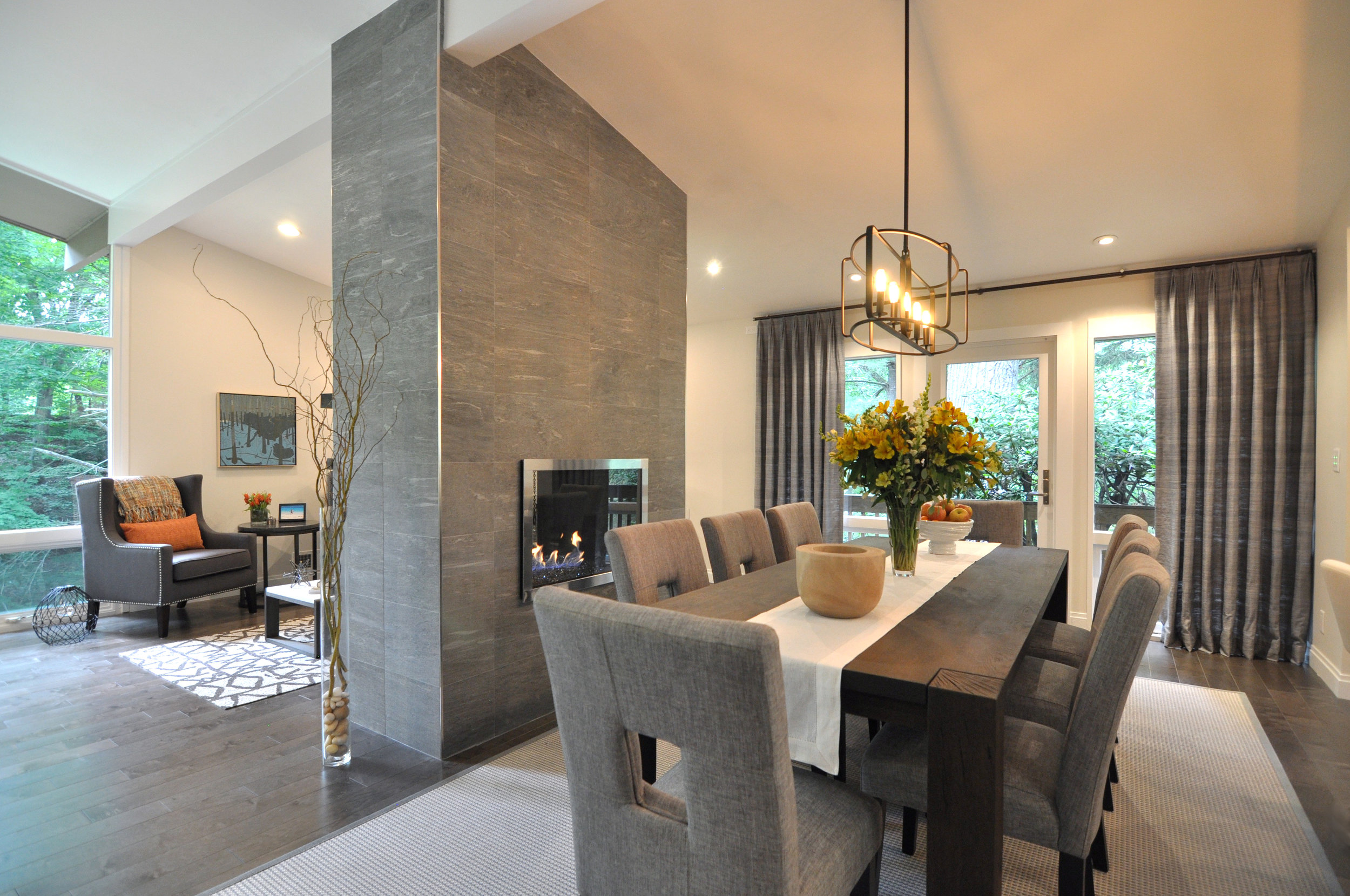Kim A Mitchell_Design Lead_The Property Brothers_Season 6_Episode 9_Modern Dining Room_View To Family Room_Fireplace Divider Wall_2017.jpg