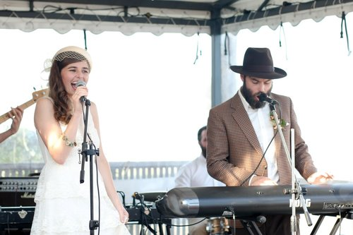 C.P (Co Founder Of At Large Audio) and Fiona, his bride, singing 'Home' through a Speaker Suitcase sound system at their wedding. Sam, the other co founder, is on the drums.