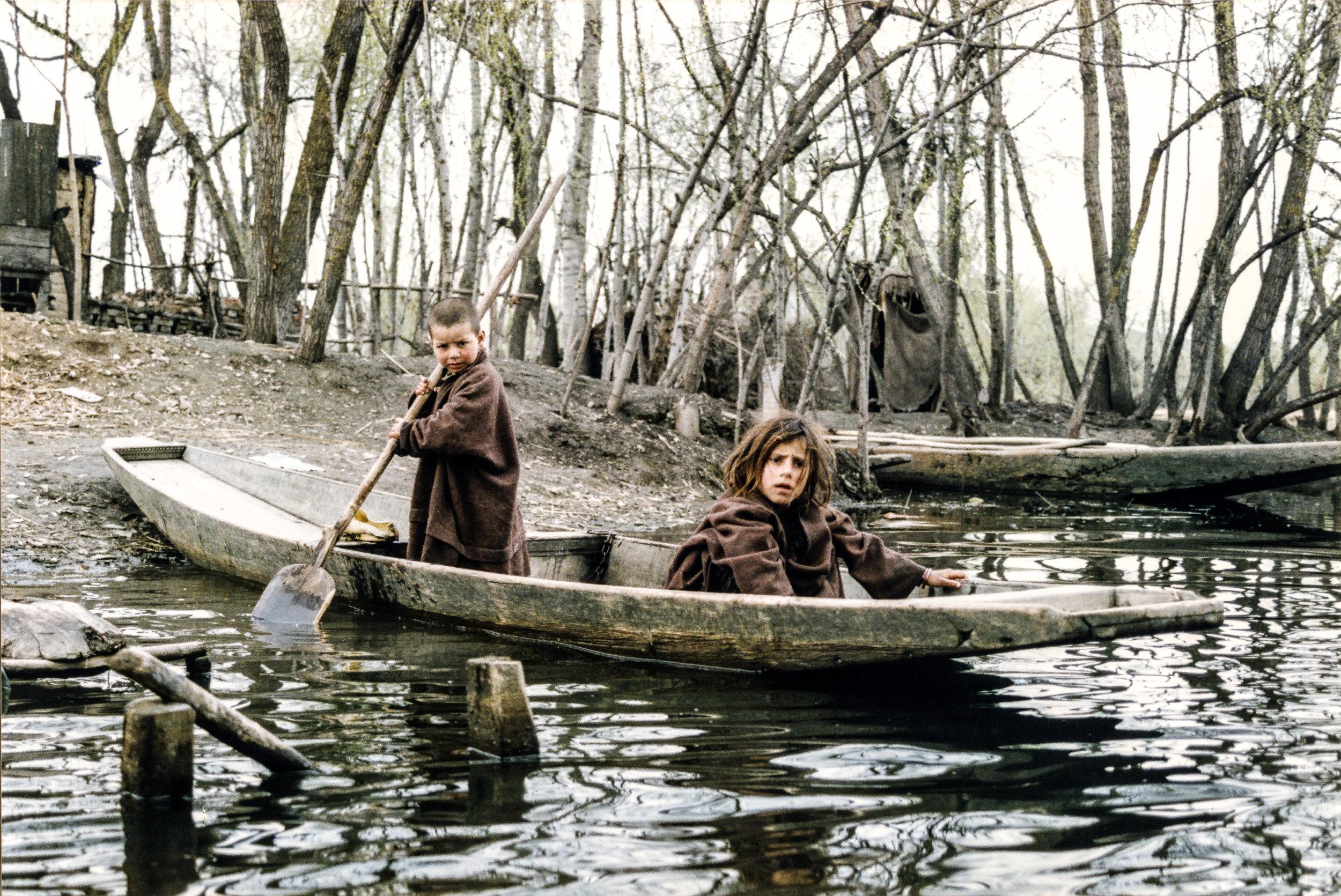 Children in boat. Dal Lake, Kashmir