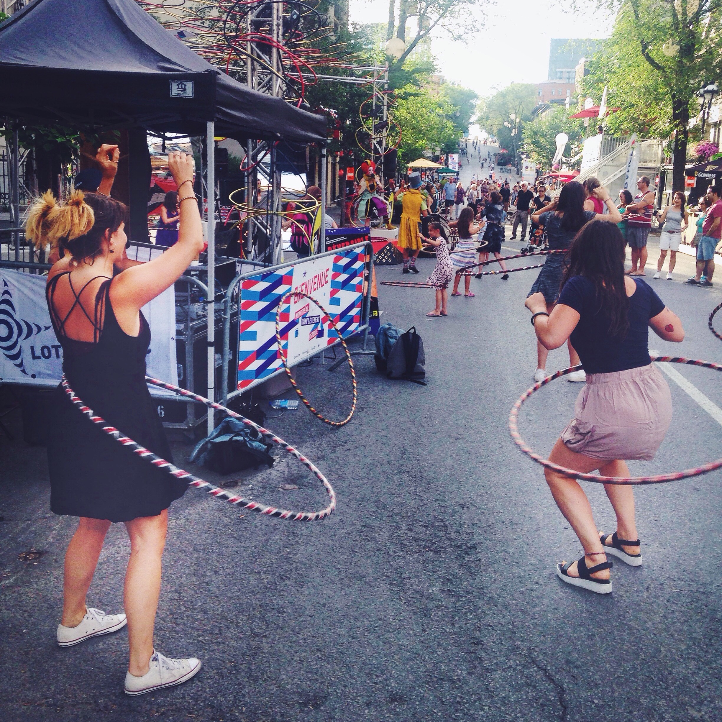Hula hooping at a circus street festival on Rue St- Denis