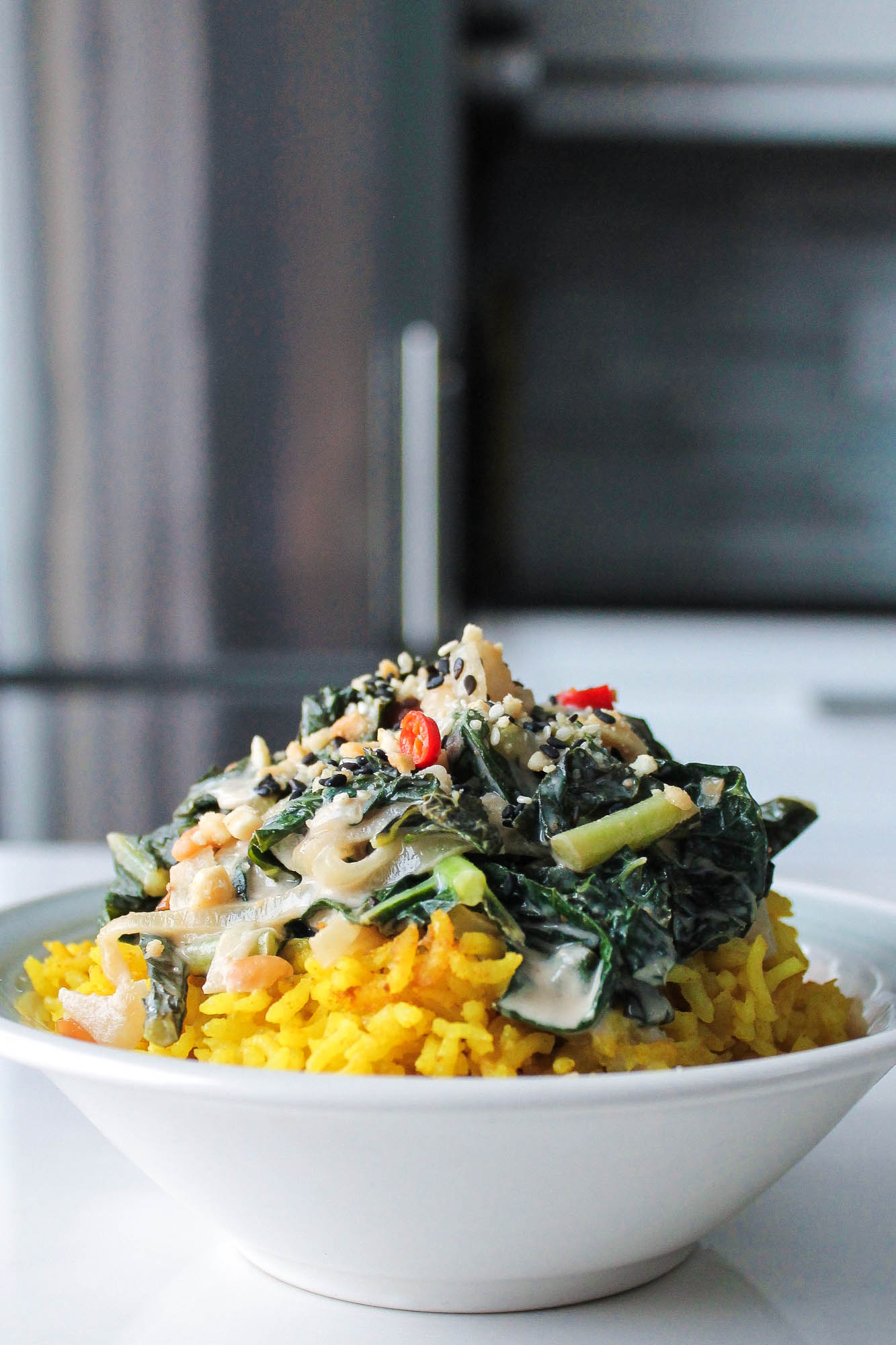 Braised Coconut Milk + Peanut Greens with Ginger Turmeric Rice || This simple recipe for coconut curried kale over turmeric rice is healthy, vegan and a 30 minute meal! Dairy free, gluten free, + plant based. || creamandhoney.ca