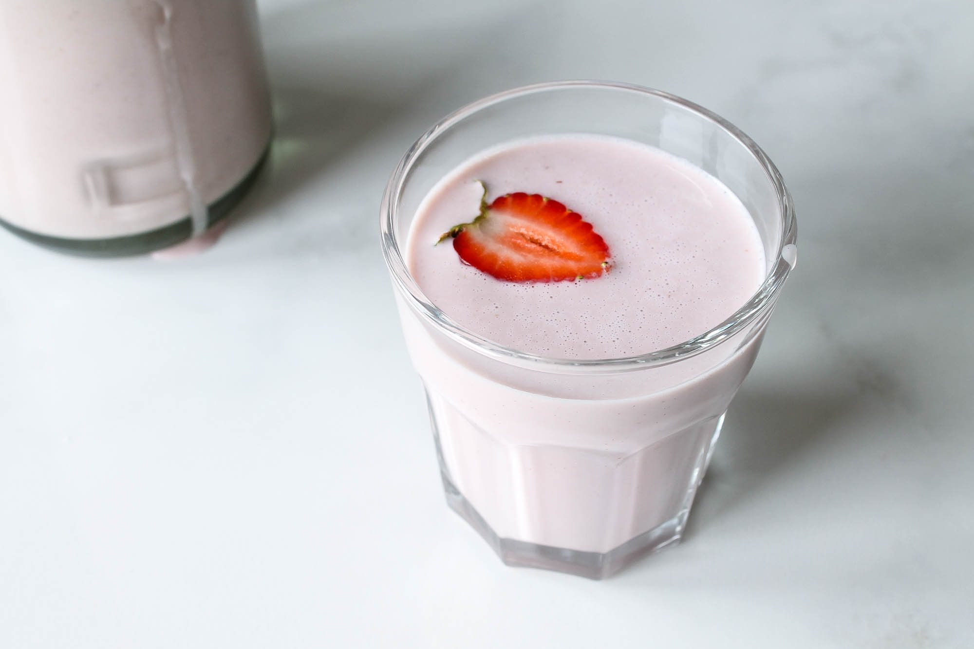 Strawberry Cashew Milk || All natural plant based nut milk made with fresh strawberries and no refined sugars. Delicious on its own at breakfast or poured over granola as a snack. Dairy free + vegan. || creamandhoney.ca