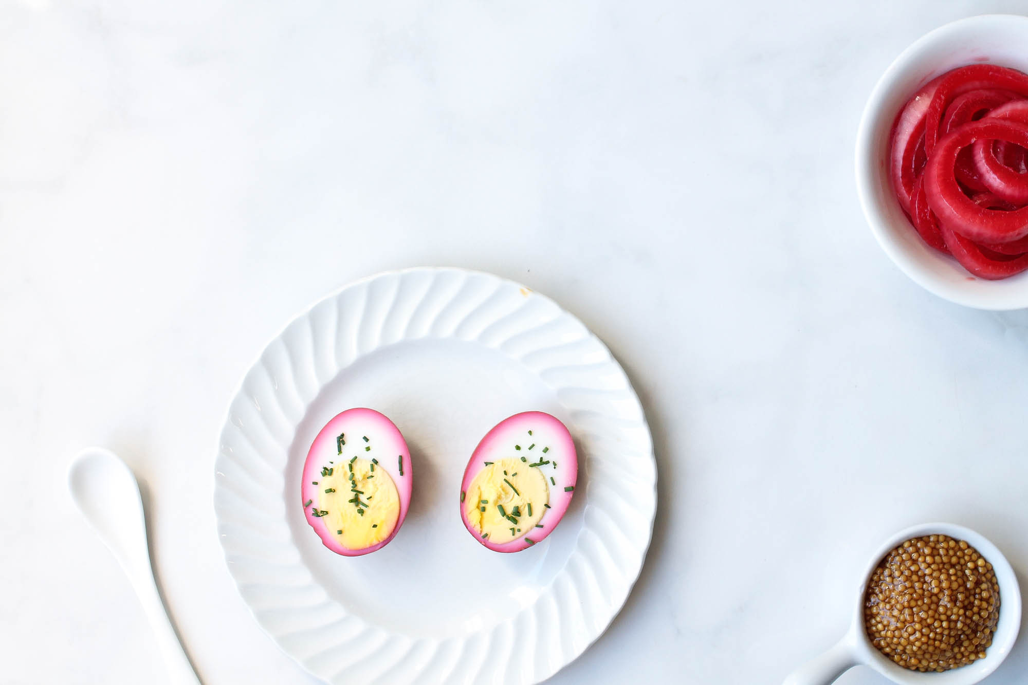 Beet Pickled Eggs + Mustard Caviar || A delicious and simple snack recipe that is perfect for parties or every day meals! Serve pink eggs w/ fresh herbs, chopped vegetables, a nice slice of toast + mayo or yogurt. || creamandhoney.ca