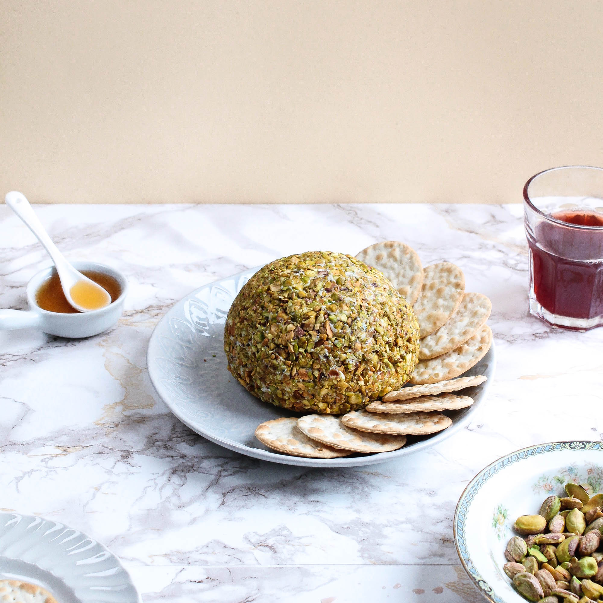 STILTON PEAR CHEESE BALL W/ PISTACHIOS + PINK PEPPERCORNS