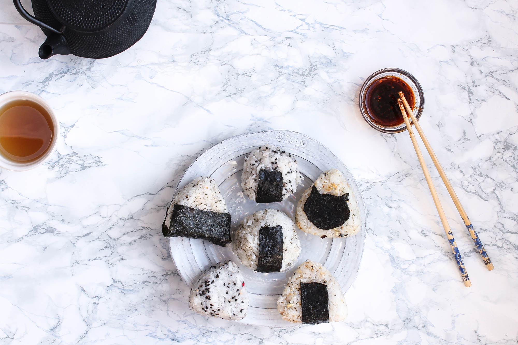How To Make Onigiri (Japanese Rice Balls) || These delicious and simple snacks are easy to make and fun to shape and decorate. Made with sushi rice and filled with many different toppings like cucumber, avocado, tuna, + umeboshi (pickled plum). gluten free, dairy free, sugar free, plant based. || creamandhoney.ca
