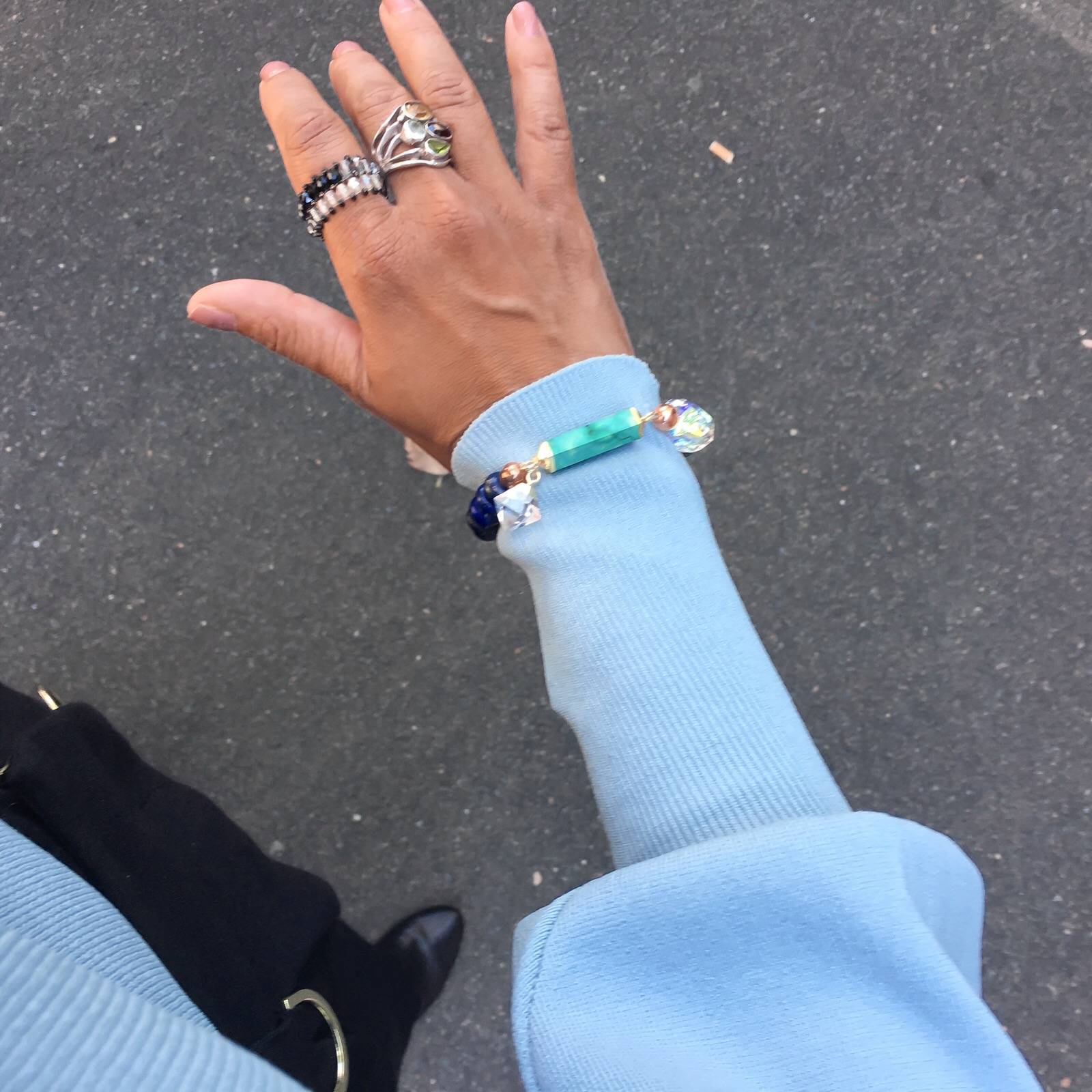 Styling your bracelet so it is part of your outfit. Drawing attention to your wrist and adding a little drama and spark to ones work style.