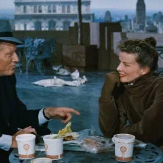 Tracy & Hepburn enjoying a winter sandwich in Desk Set. Image from Monroe County Public Library.