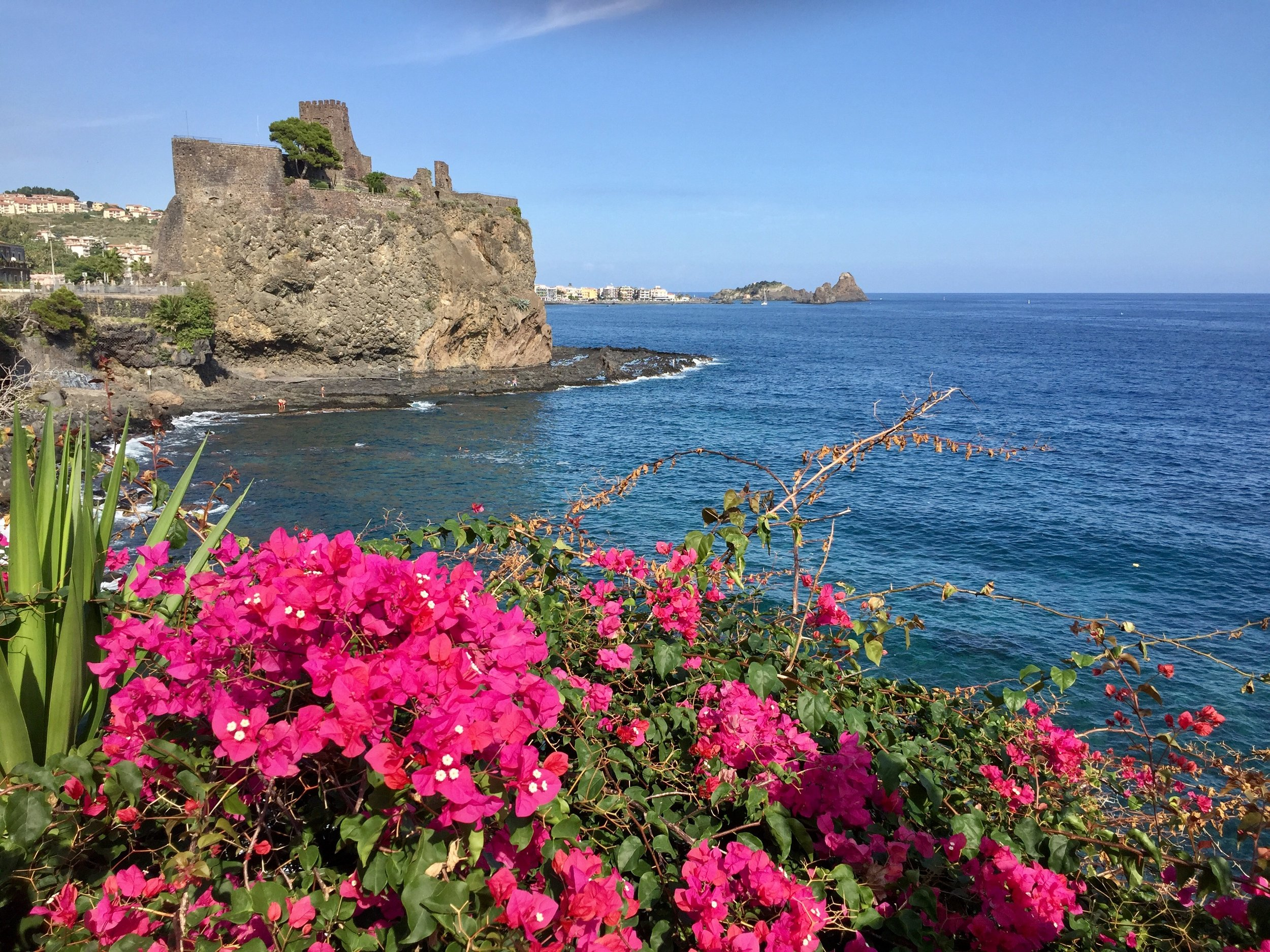 In the scenic seaside town of Acitrezza just outside Catania, you can enjoy a peaceful stroll overlooking the beautiful Aci Castello