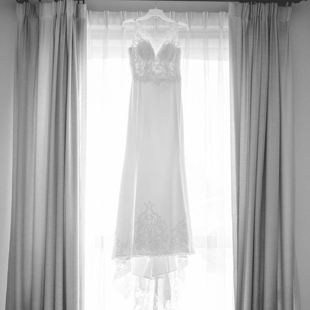 A quintessential wedding dress hanging in a window! Perfection...⁠ ⁠ #TCWeddings #TCTeasers