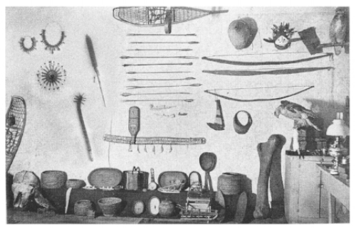 Curio shop, circa 1893, rural Kansas. Pianista artifacts seen to the upper left: Ceremonial Necklaces, Prayer Wheel, Talking Stick, and War Club.