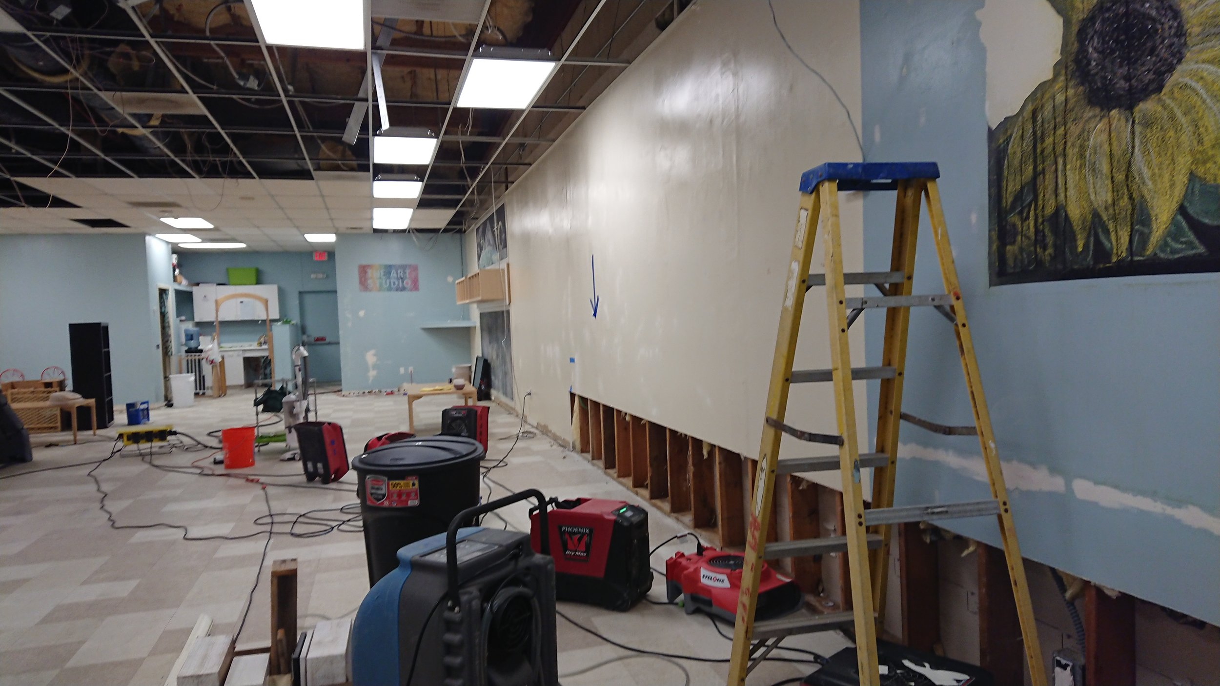 December 19th, most furniture has been put in storage, damaged ceiling tiles removed, and starting drywall repair