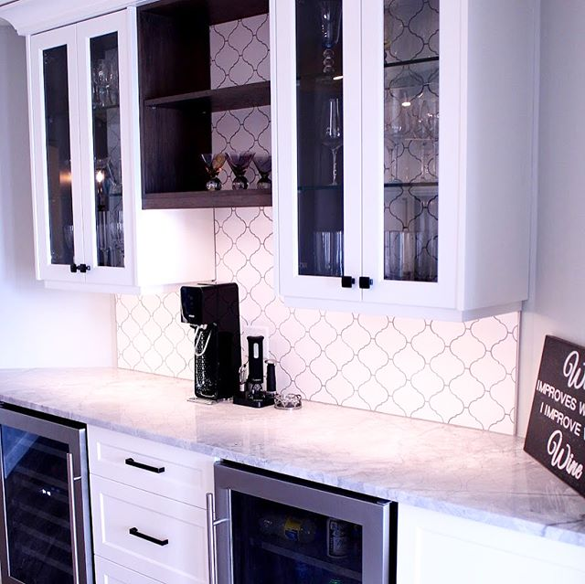 Grey stain hickory boxes with inset tile backs, glass shelves, white lacquer glass doors and super white counters