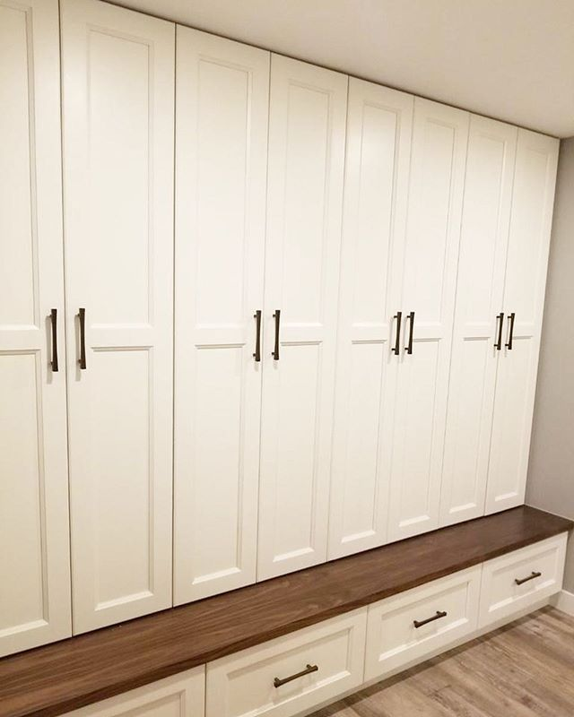 Locker units with white lacquer shaker doors, walnut bench and black hardware . . . . . #cabinets #cabinetdesign #lockers #walnut #whitelacquer #renovations #yqr
