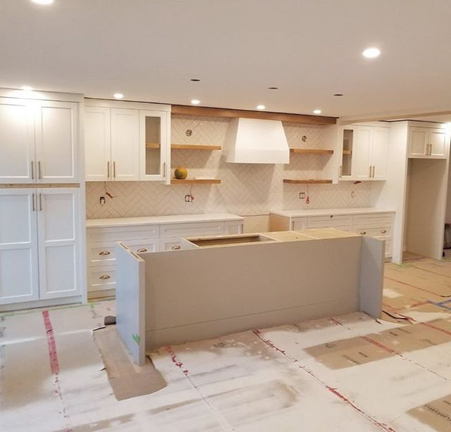 Nearing completion on this stunning renovation with @citizendesignco . . . . . #renovation #remodel #customcabinets #kitchendesign #quartzcountertop #kitchenisland #whiteoak #yqr