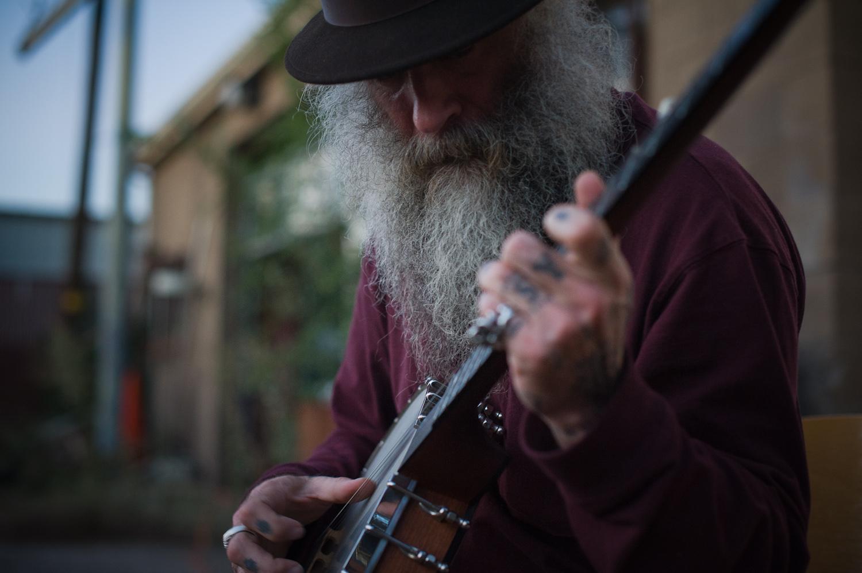Daniel Higgs plays his banjo.