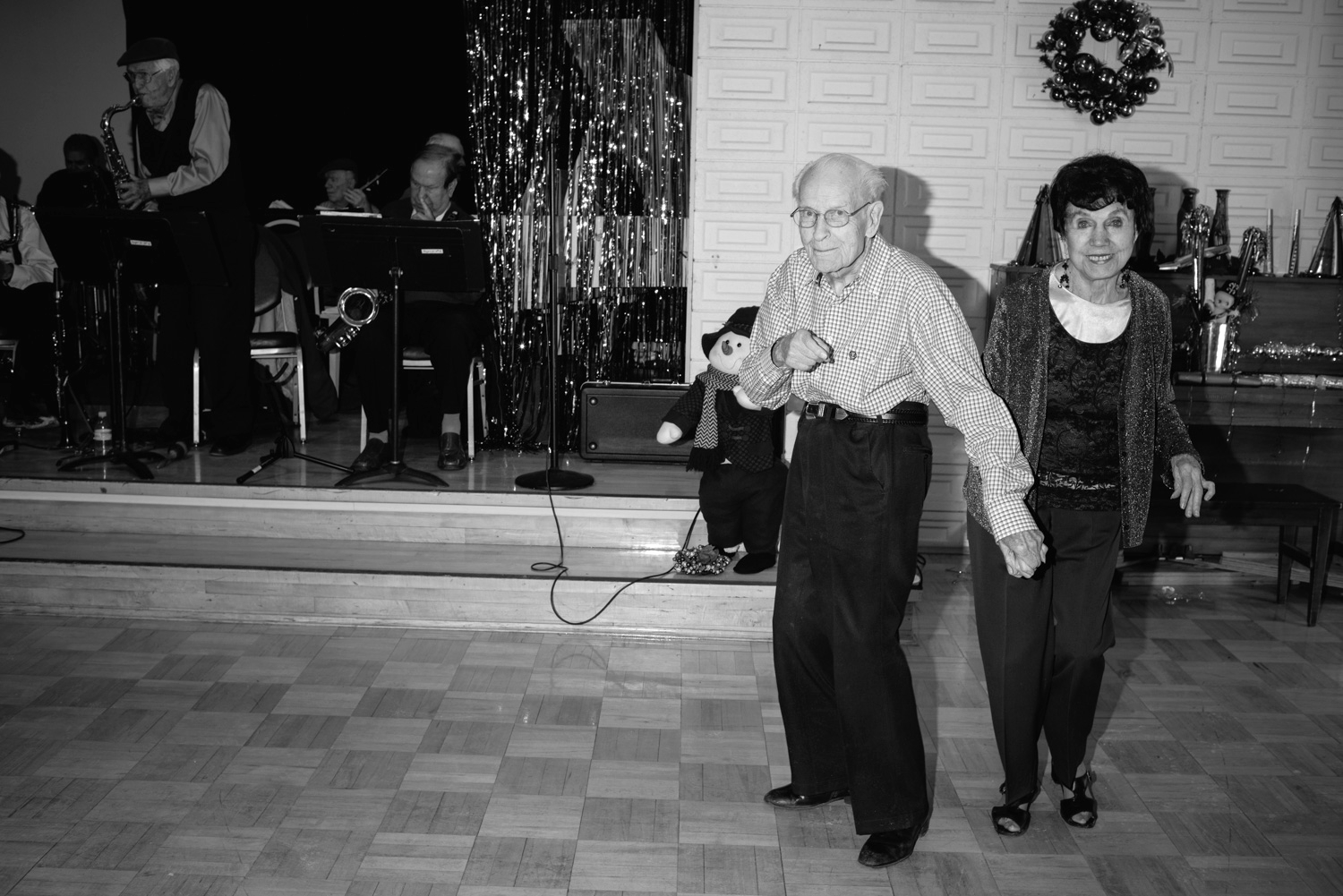 The Salt Lake City Tenth Street Senior Center holds biweekly senior dances featuring live jazz bands also comprised of seniors. My dad plays drums in one of the bands and I often go check out the scene. All of this happens before noon.  Salt Lake City, Utah.