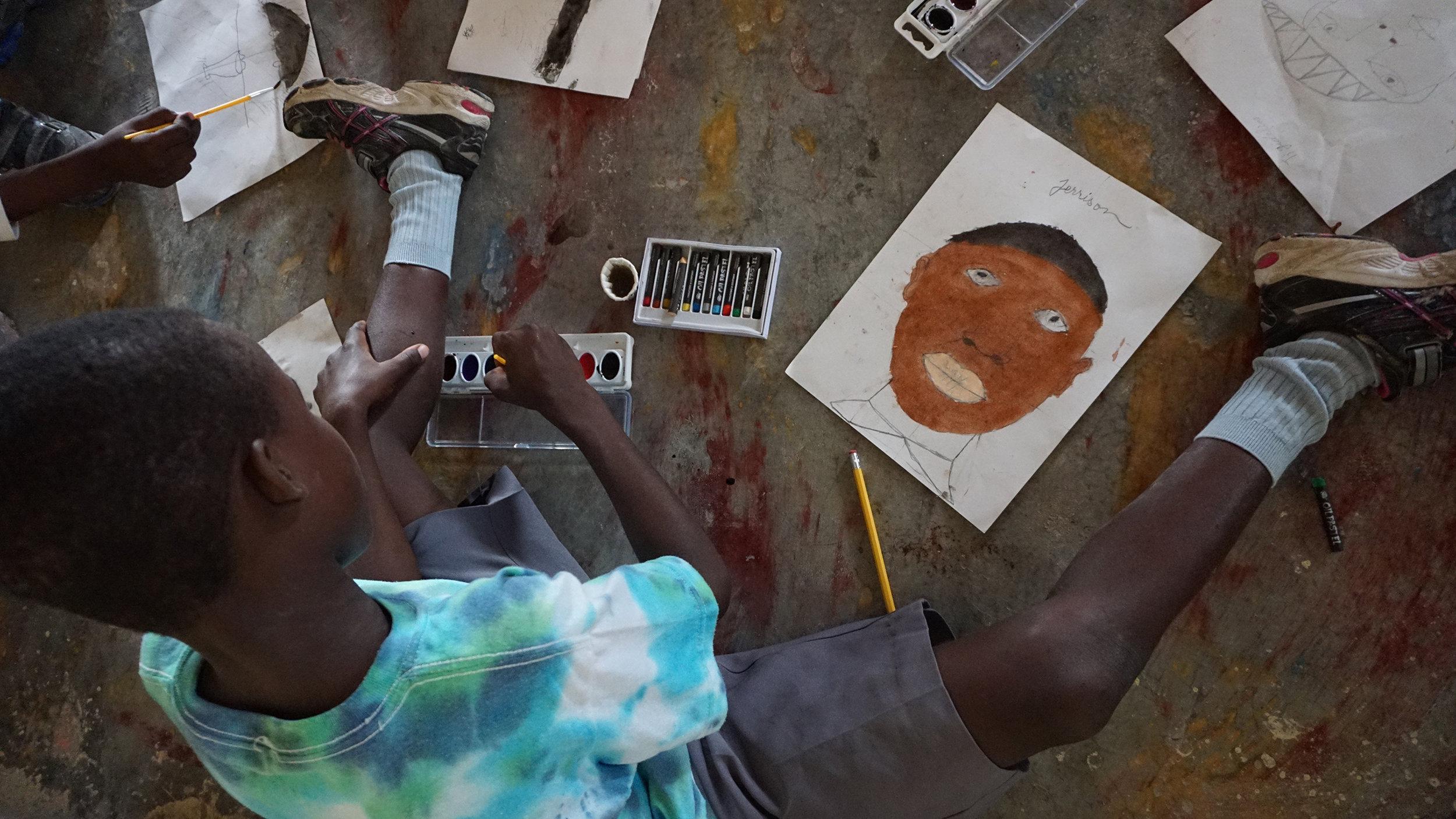 Hague Williams teaching art to children.