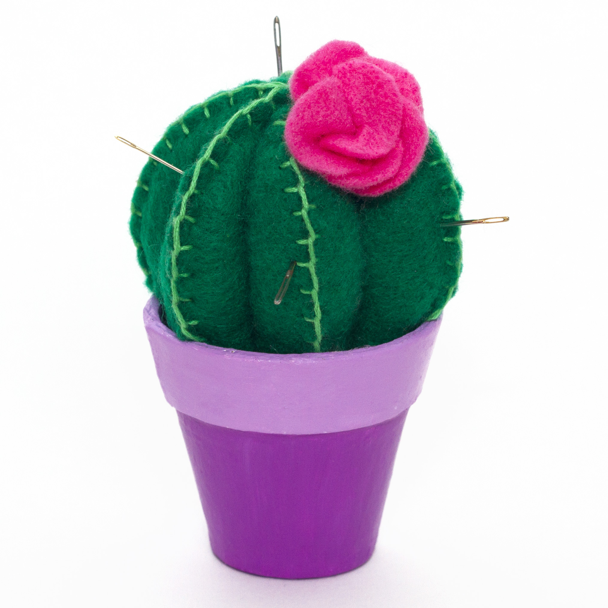 Step 5  Finally, sew the flower onto the cactus pin cushion. Paint the flowerpot if necessary to make it more colourful. Pop the cactus into the mini plant pot (glue it in if you don't want it to move, or leave it loose and keep spare pins and thread underneath!)  Now you have a fun quirky cactus to keep all of your pins in for your crafting needs!  Subscribe to my  newsletter  to receive fun craft ideas weekly!