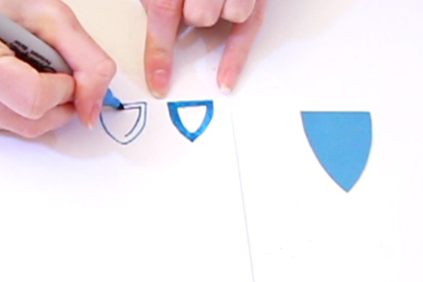 Step 5  Cut out a princess castle door shape from the blue paper, draw on a door knob and other features. Draw 3 window frames with the blue pen onto the white paper and cut out.