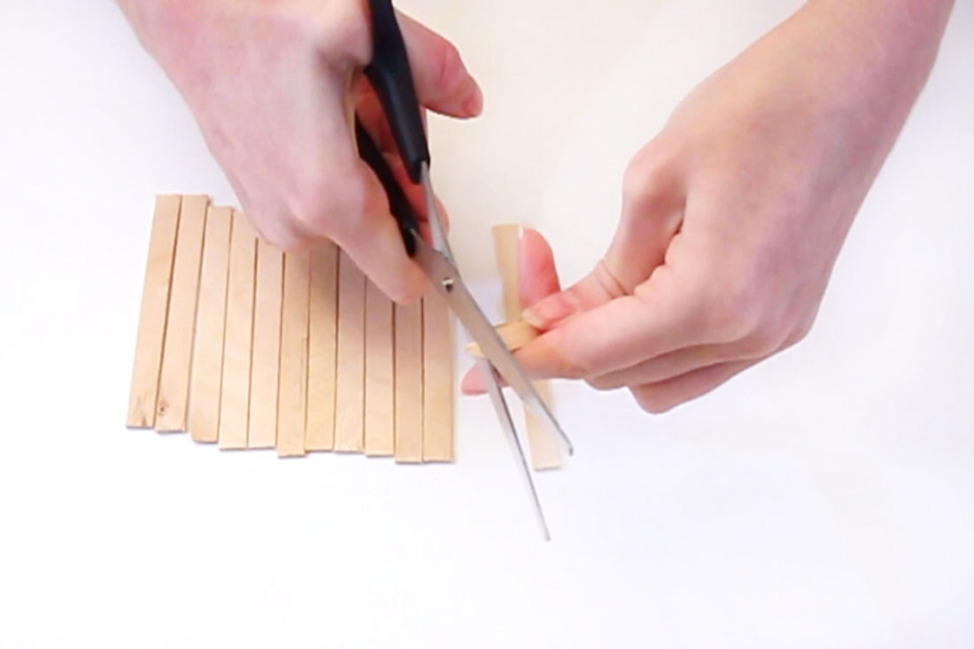 Step 1  Cut the rounded ends off of the lolly sticks. Be careful not to get splinters as the wood can be quite sharp! Sand them down in necessary.
