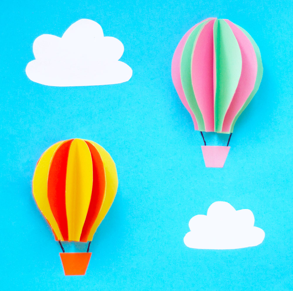 Step 4  Create as many hot air balloons as you wish. Then cut out some cloud shapes from white paper and stick these down and you're finished!  Subscribe to my  newsletter  to receive fun craft ideas weekly!