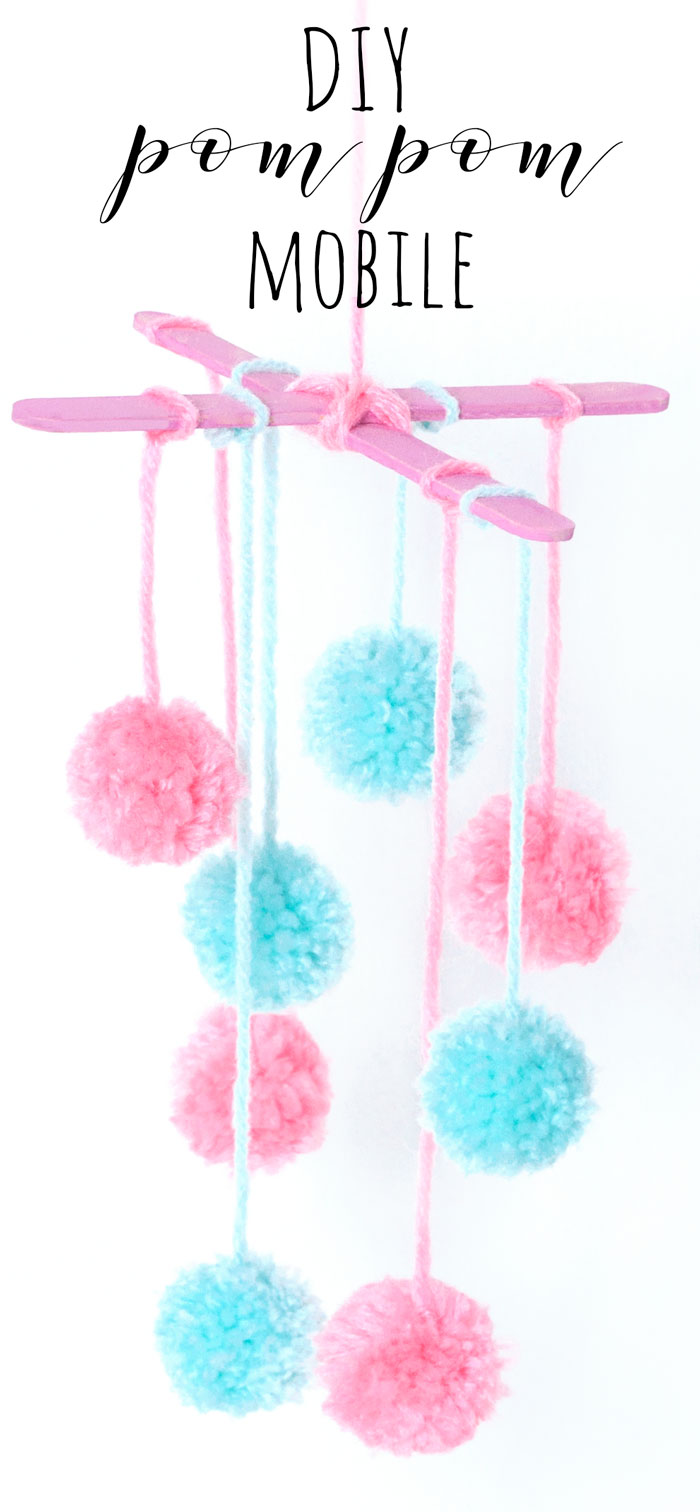 Make a pretty mini pom pom mobile out of wool and lolly sticks. This craft would look lovely hanging in the nursery/baby's room, or create it with colourful wool to make some funky home decor!