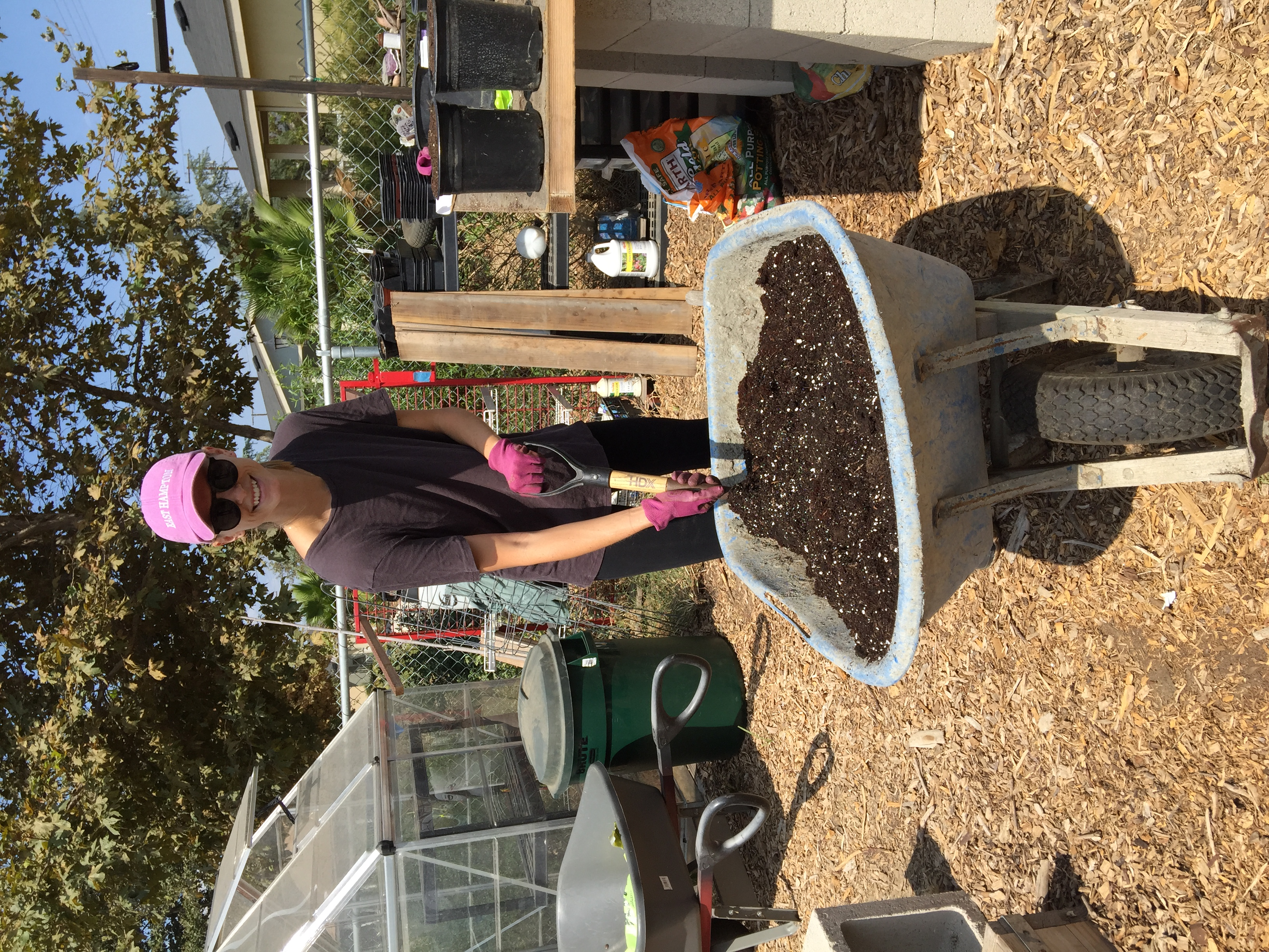 Superstar volunteer Maria Beale mixing soil.