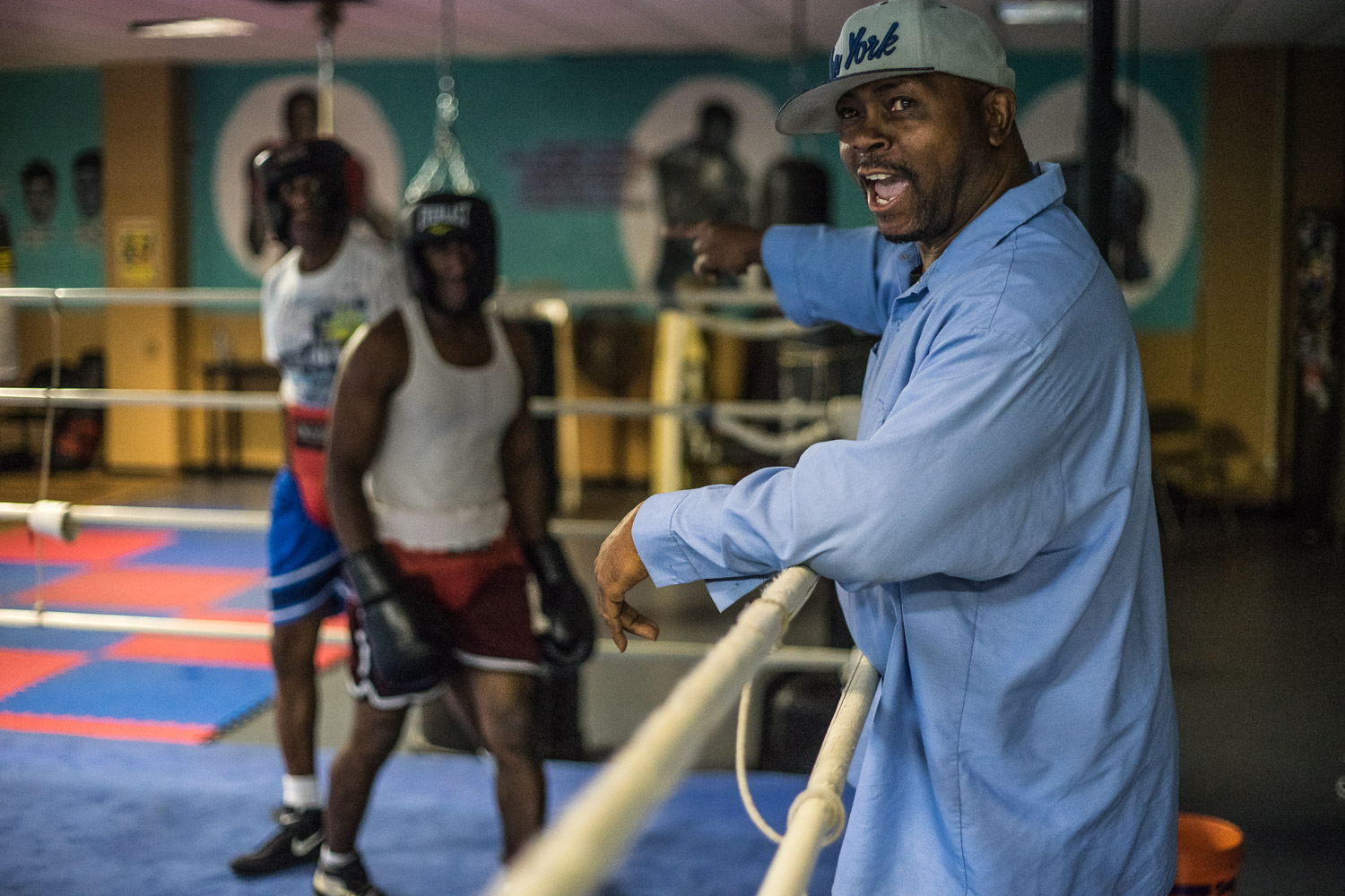 """""""You wanna be beaten by a cop?"""", shouts Nate Boyd as he encourages Shakka to get closer to a police officer with the New York City Police Department (NYPD). NYPD officers use the gym to train for competitions such as 'Battle of the Badges'. This is a way for NYPD to develop relationships with the Bedstuy community, especially with some mistrust among some members of the community and law enforcement."""