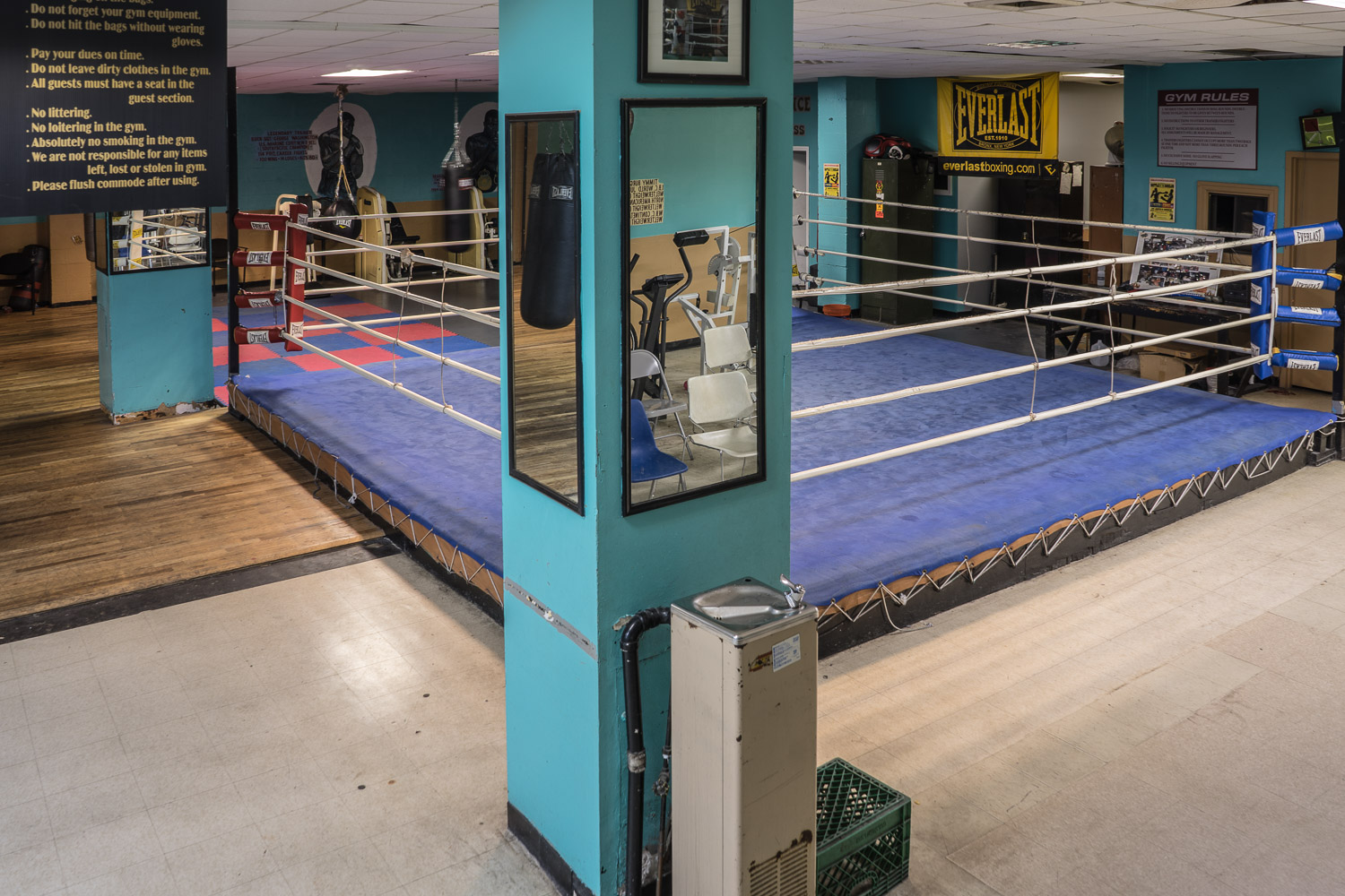 The gym has a full size ring, boxing bags and some weights equipment.