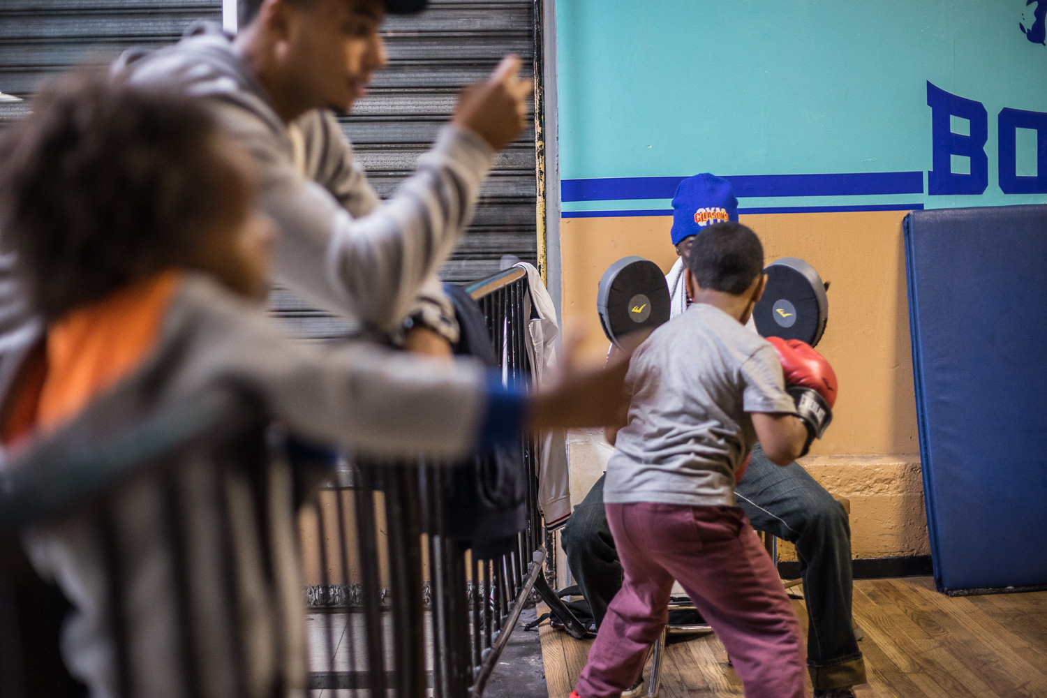 """""""Some days, I've so many kids I don't know where to put them, so I put them in the gym and get them moving around"""", says Nate Boyd, head boxing coach at the gym."""