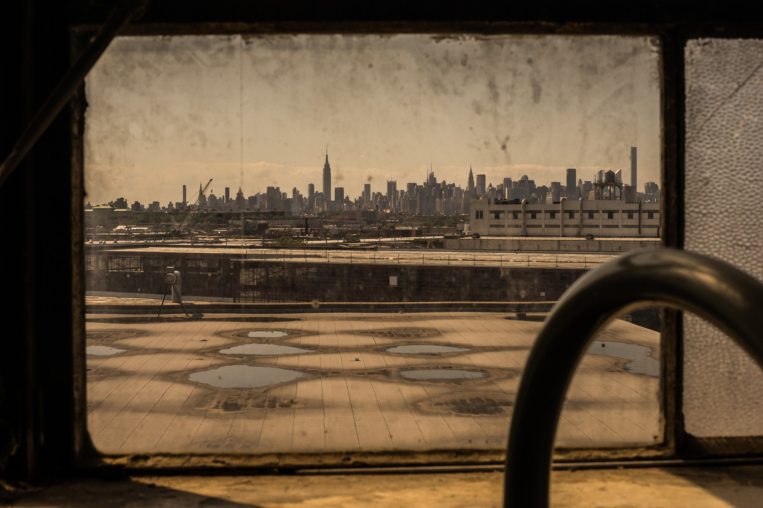 """Manhattan's skyline is visible in the distance. Increasingly,new people are moving to Bedstuy, changing a traditionally African-American demography. As rents rise,families move from the area further into Brooklyn. """"You know man, change is coming"""", Nate Boyd says. It's time again for Bedstuy boxing to 'do' rather than 'die'."""