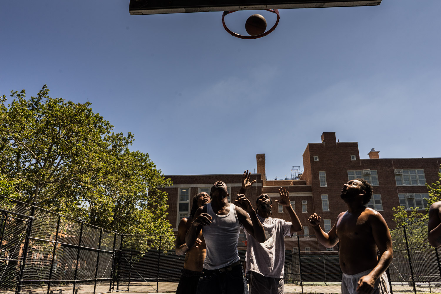 Pop Zombie (left rear) and Fatboy (right front) play streetball with friends in Bedstuy, Brooklyn.