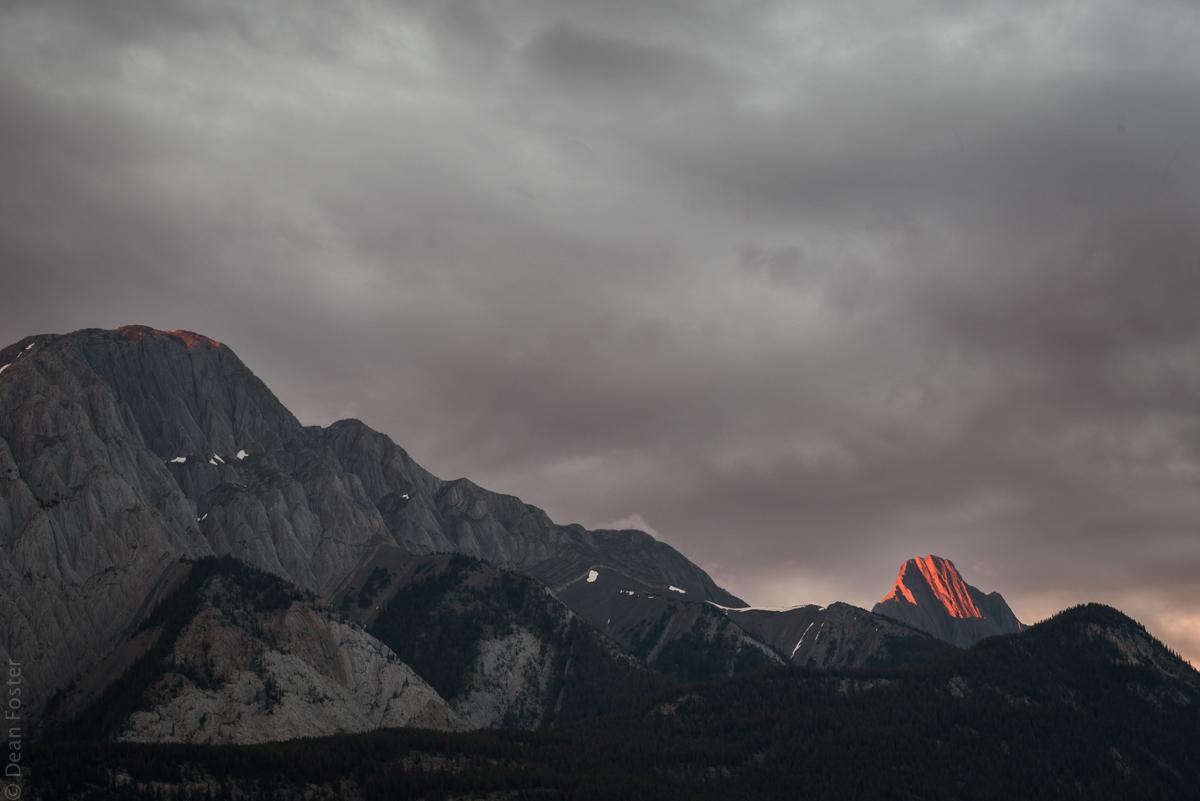 The sun's last light pokes through otherwise overcast skies