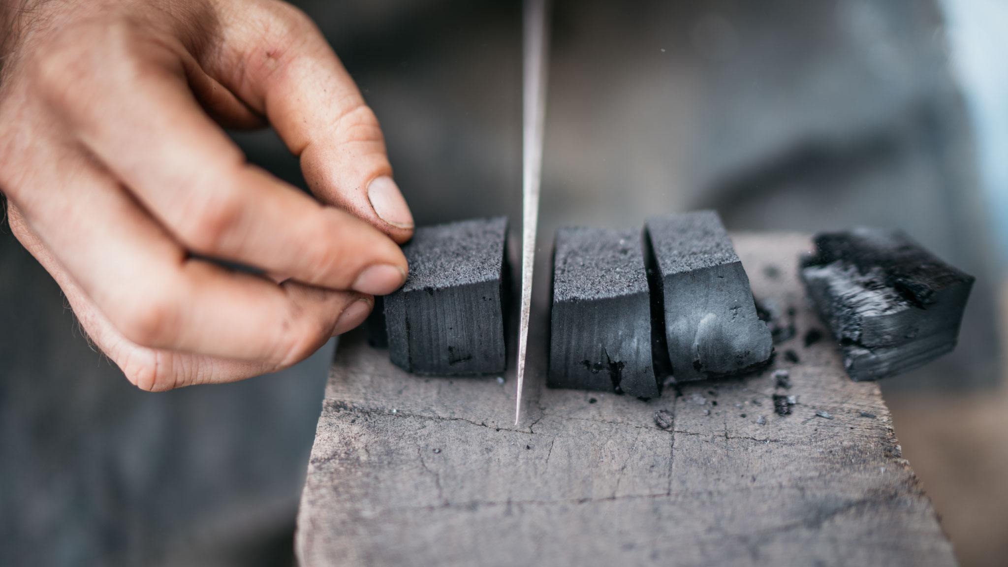 Pine charcoal is made and cut into pieces for use in the forge.