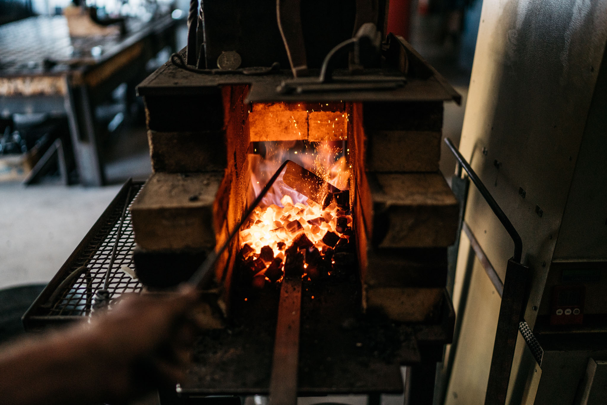 Steel is heated in the forge using a mixture of pine charcoal and coke.