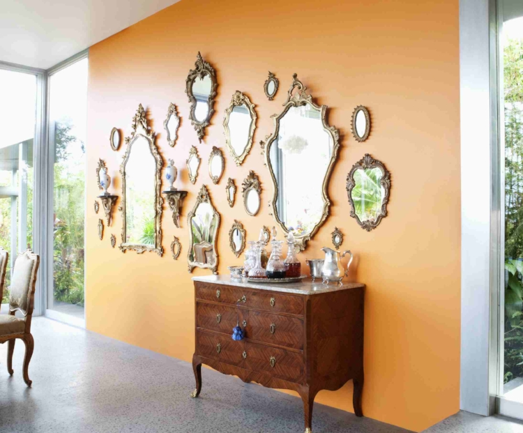 By itself this cabinet would be lost. But the repetition of its shape and finish in the mirrors make it much larger. Image Source : The Spruce