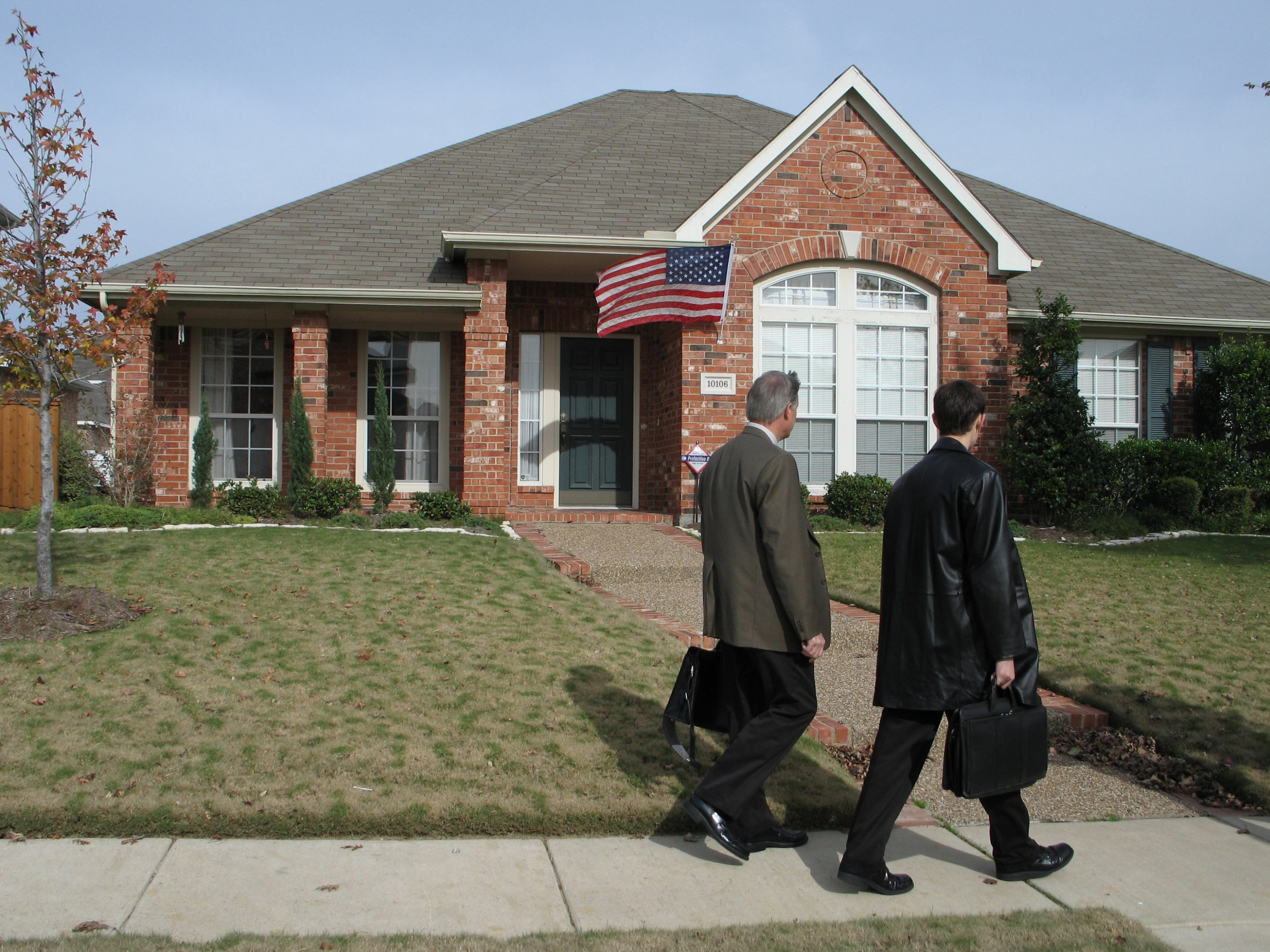 """Jehovah's Witnesses in the PBS documentary """"Knocking"""" visit a door in Dallas."""