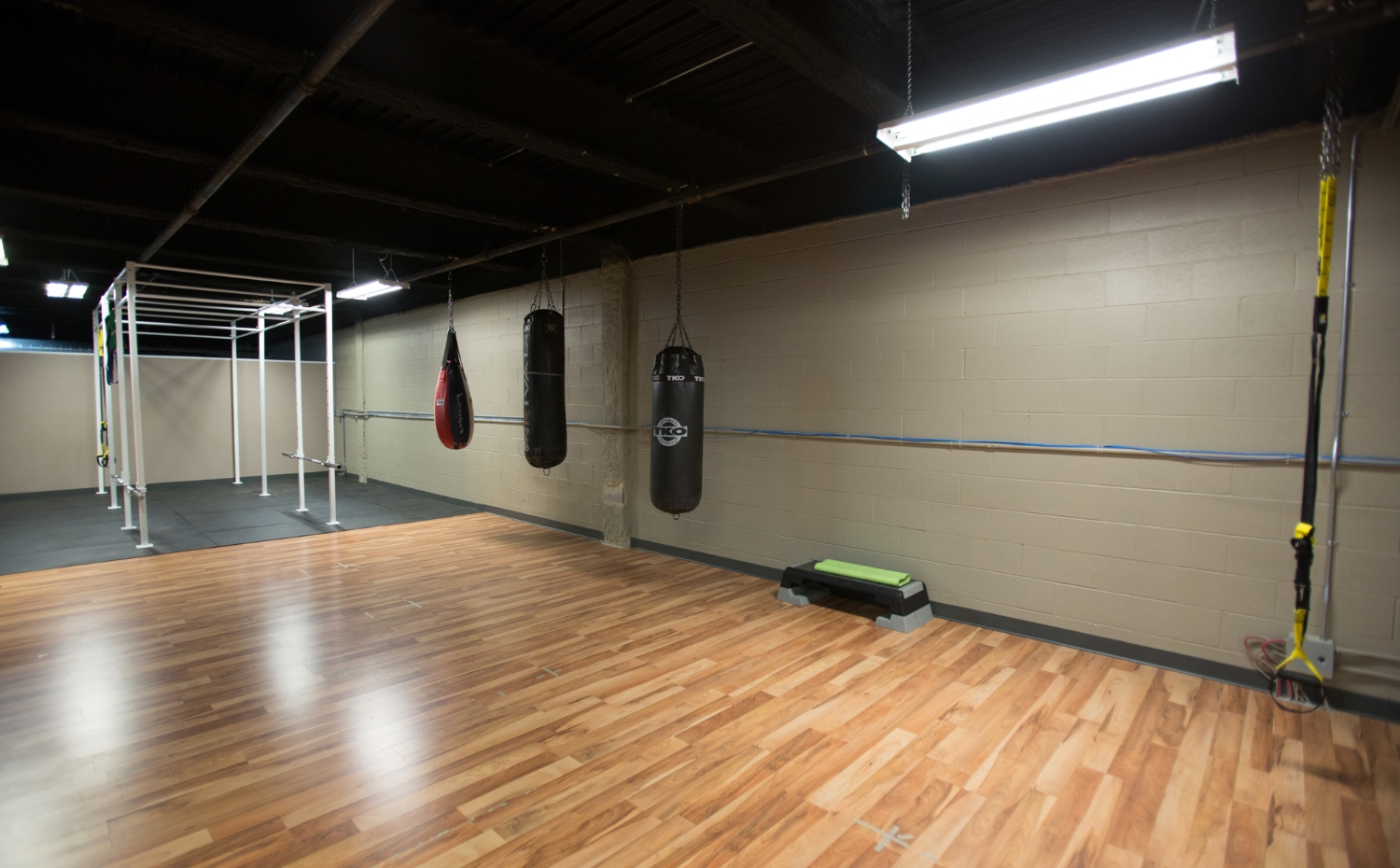 The upper level of our facility boasts a large area with punching bags, monkey bars and more!