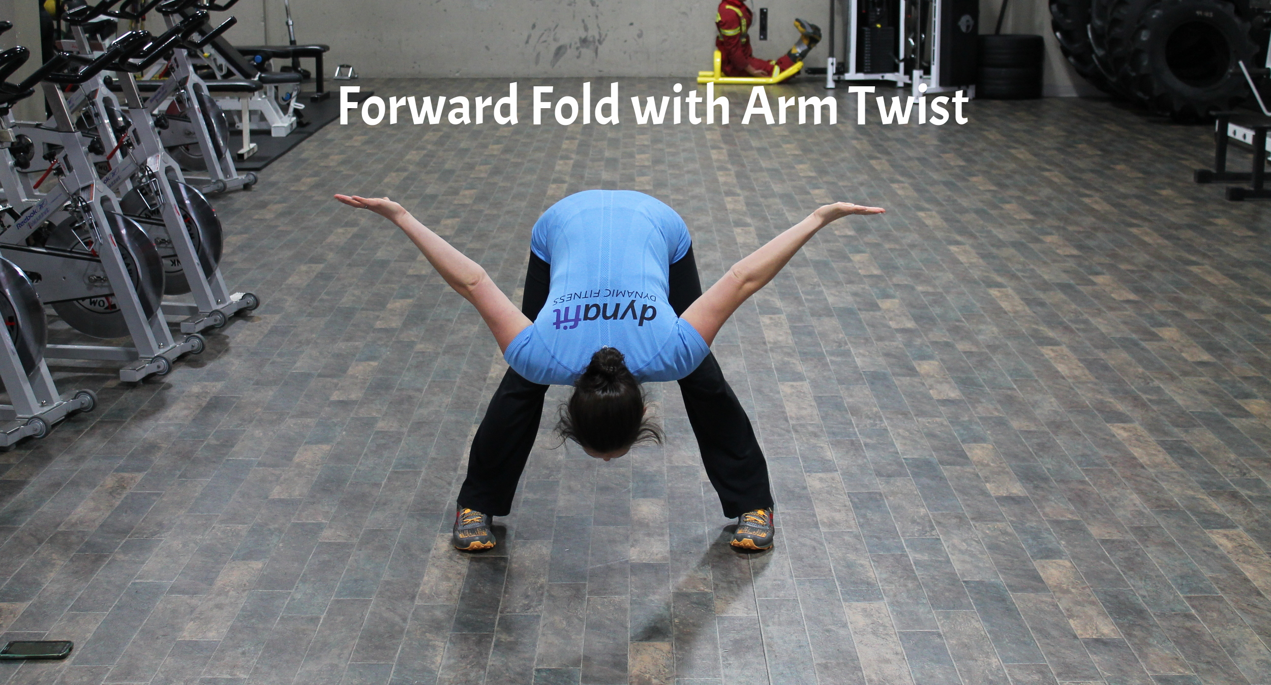 Stand with feet hip width apart (or slightly wider) bend forward from the waist, keeping a very slight bend in the knees. As you fold forward, take the arms out to a 'T' position and turn the palms towards the sky. Hold for 30 to 60 seconds.
