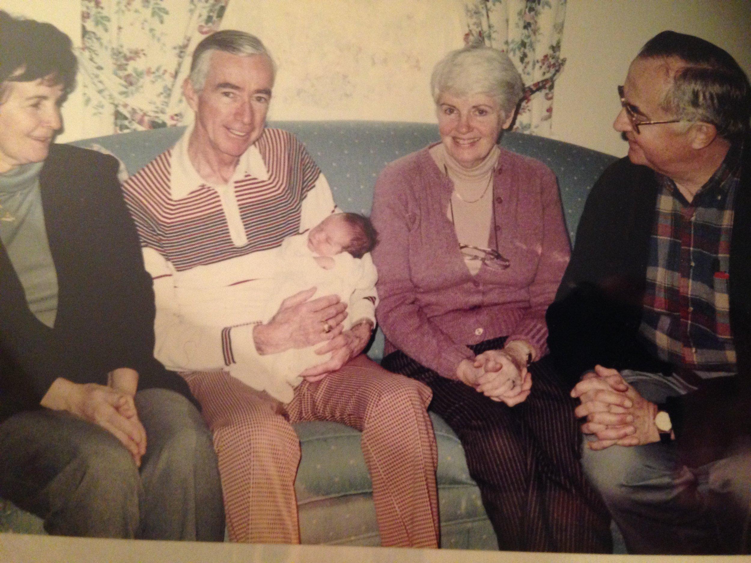 James P. Harvey holdings his namesake. Irene O. Melville on his left.JPG