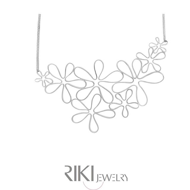See more necklaces like this **Flower Bib** at www.rikisjewelry.com