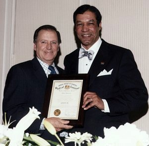 Leonard Kleinpeter, representing Governor Kathleen Babineaux-Blanco's office presents Rhaoul A. Guillaume, Sr. with the proclamation from the State of Louisiana