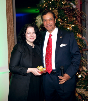 Rhaoul A. Guillaume, Sr. awards Ms. Zeringuewith a five year service pin during the 2013Christmas party