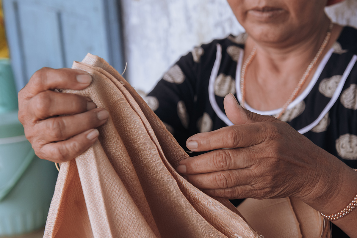 These ancient brocade textiles have been woven for centuries.  Photography by Ody.